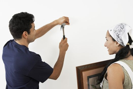 Couple Hanging Picture