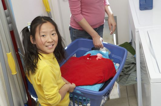 Woman and Daughter Doing Laundry