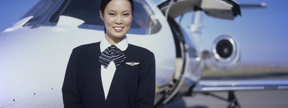 Member of Flight Crew Standing by Airplane