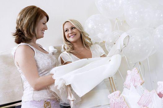 Bride Showing Off Dress at Bridal Shower