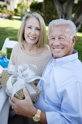 Couple Holding a Gift