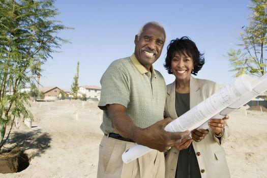 Couple Holding Blueprints