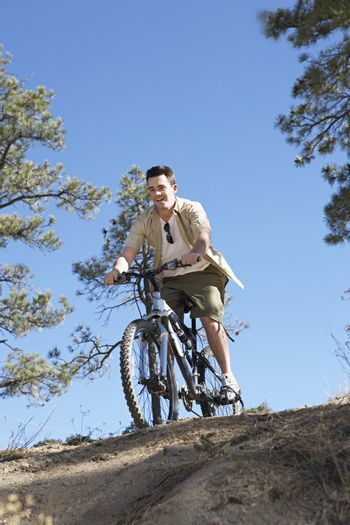 Mountain Biker at Top of Hill