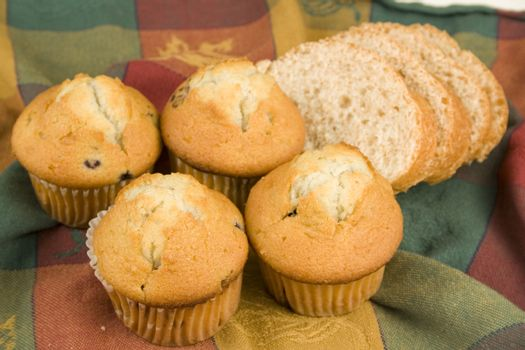 Bread and muffins on nice table cloth