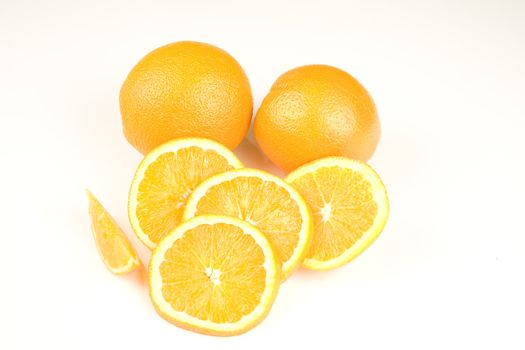 Oranges and slices isolated on white background