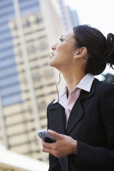 Businesswoman Using Earphone