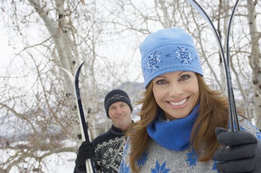 Smiling Couple with Cross-country Skis