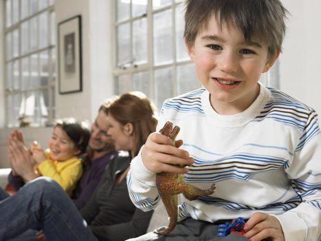 Boy with Toy Dinosaur