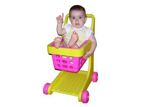 A little girl sitting in a toy shopping cart