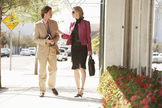 Businesspeople Walking Down Street
