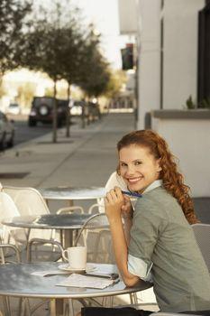 Woman at a Sidewalk Cafe
