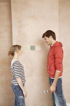 Couple Deciding Between Paint Colors