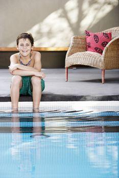 Boy Sitting By the Pool