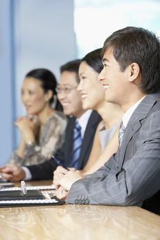 Businesspeople Listening to Speech