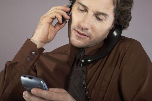 Multi-tasking Businessman Using Phones