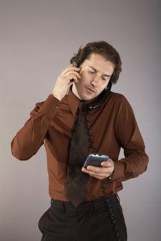 Multi-tasking Businessman on Telephone