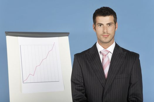Businessman Standing in Front of Chart