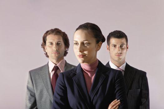 Businesswoman Standing In Front of Businessmen