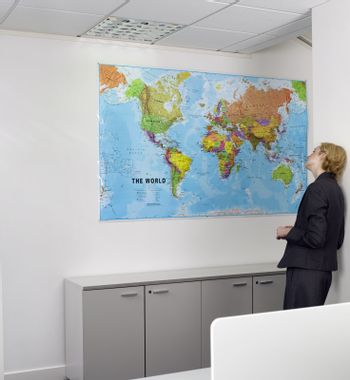 Businesswoman Looking at World Map