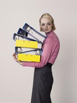 Businesswoman Carrying Empty Binders