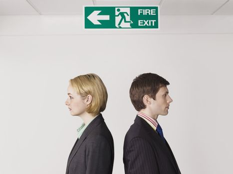 Businesspeople Under Exit Sign