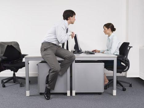 Businessman Looking at Coworker