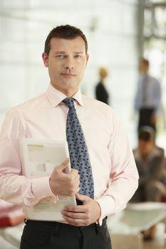 Businessman Holding Report