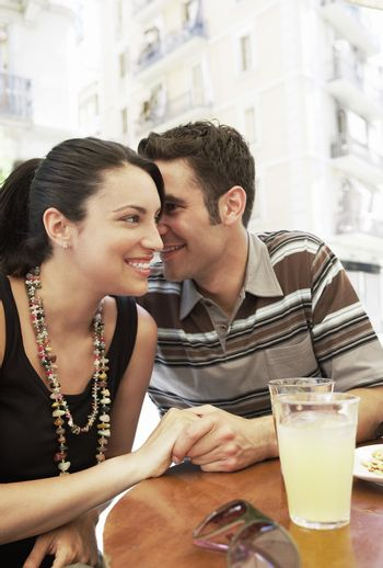 Happy Couple at a Sidewalk Cafe