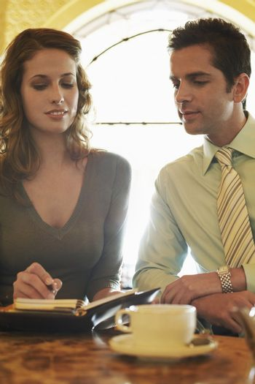 Business People Choosing a Date