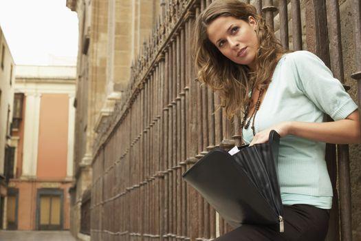 Businesswoman by Railings
