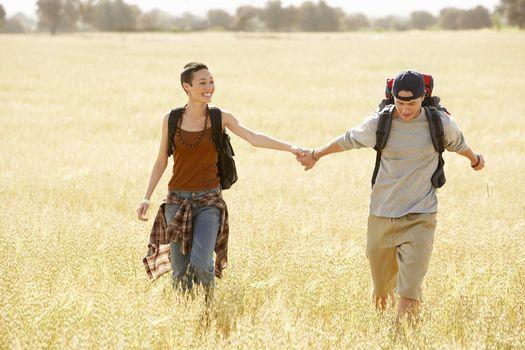 Couple Hiking in Field
