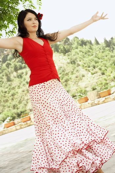 Woman Dancing in Flowing Dress