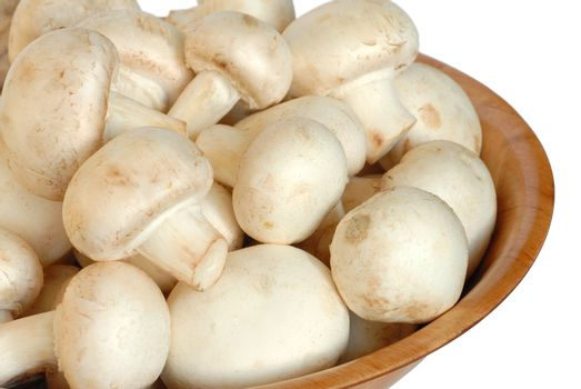Mushrooms in a bowl isolated on white background