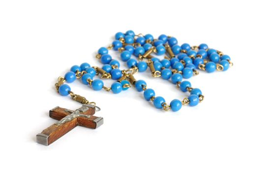 Macro of old rosary isolated on white background