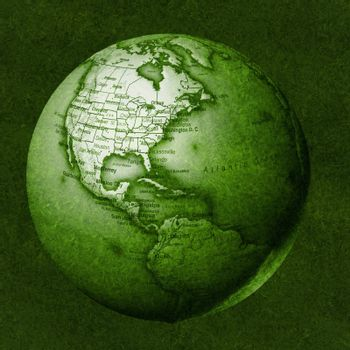 Green floating globe against a grassy background.