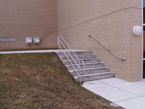 concrete steps by a brick building