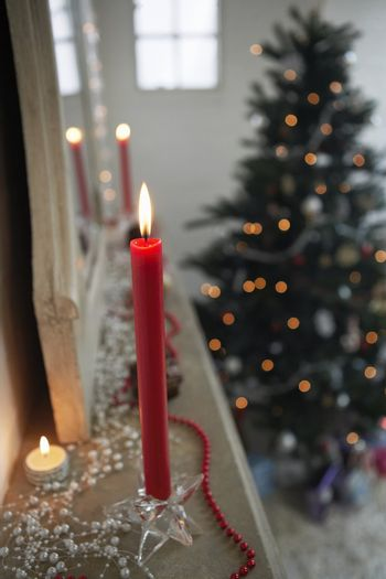 Candles Burning on the Mantel