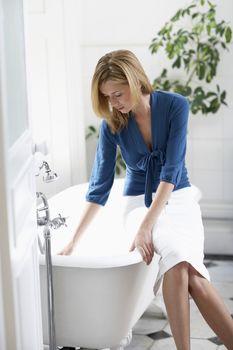 Businesswoman Filling Bathtub