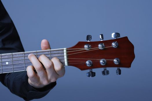 Hand Playing Neck of Guitar