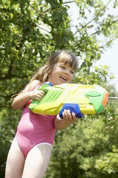 Little Girl Shooting Large Squirt Gun