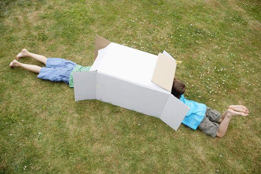 Two Boys in a Cardboard Box