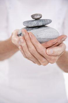 Woman Holding Stones