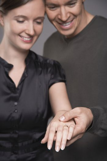 Couple Looking at Wedding Ring