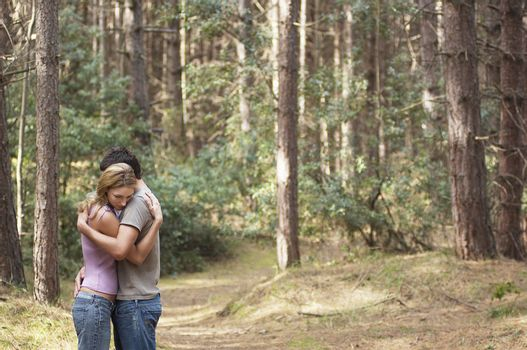 Couple Hugging on Trail in Forest