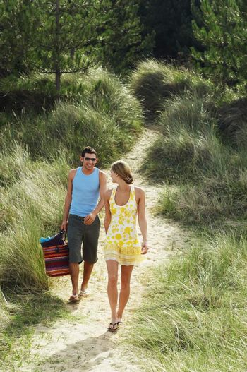 Couple Walking on Trail to Beach
