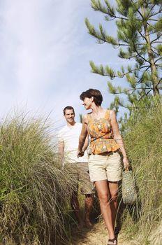 Couple Walking on Trail through Tall Grass