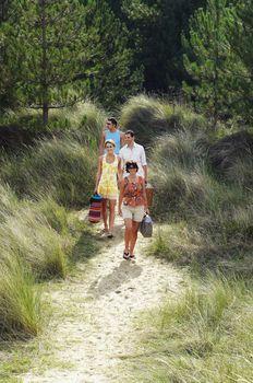 Friends Walking on Trail to Beach