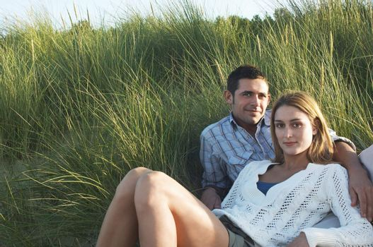 Couple Relaxing in Tall Grass