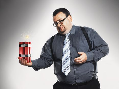 Businessman Holding Dynamite