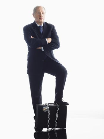 Businessman Chained to Briefcase